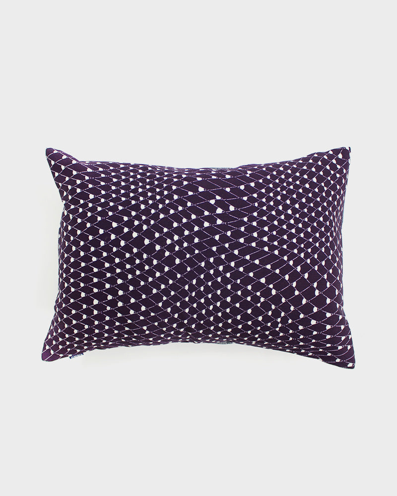 Fishing Net with Cream on Purple Pillow