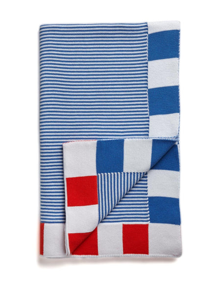 A bold, bright blue striped baby blanket, featuring a block trim of blue and red.  A traditional striped baby blanket, Made in Australia from Egyptian cotton