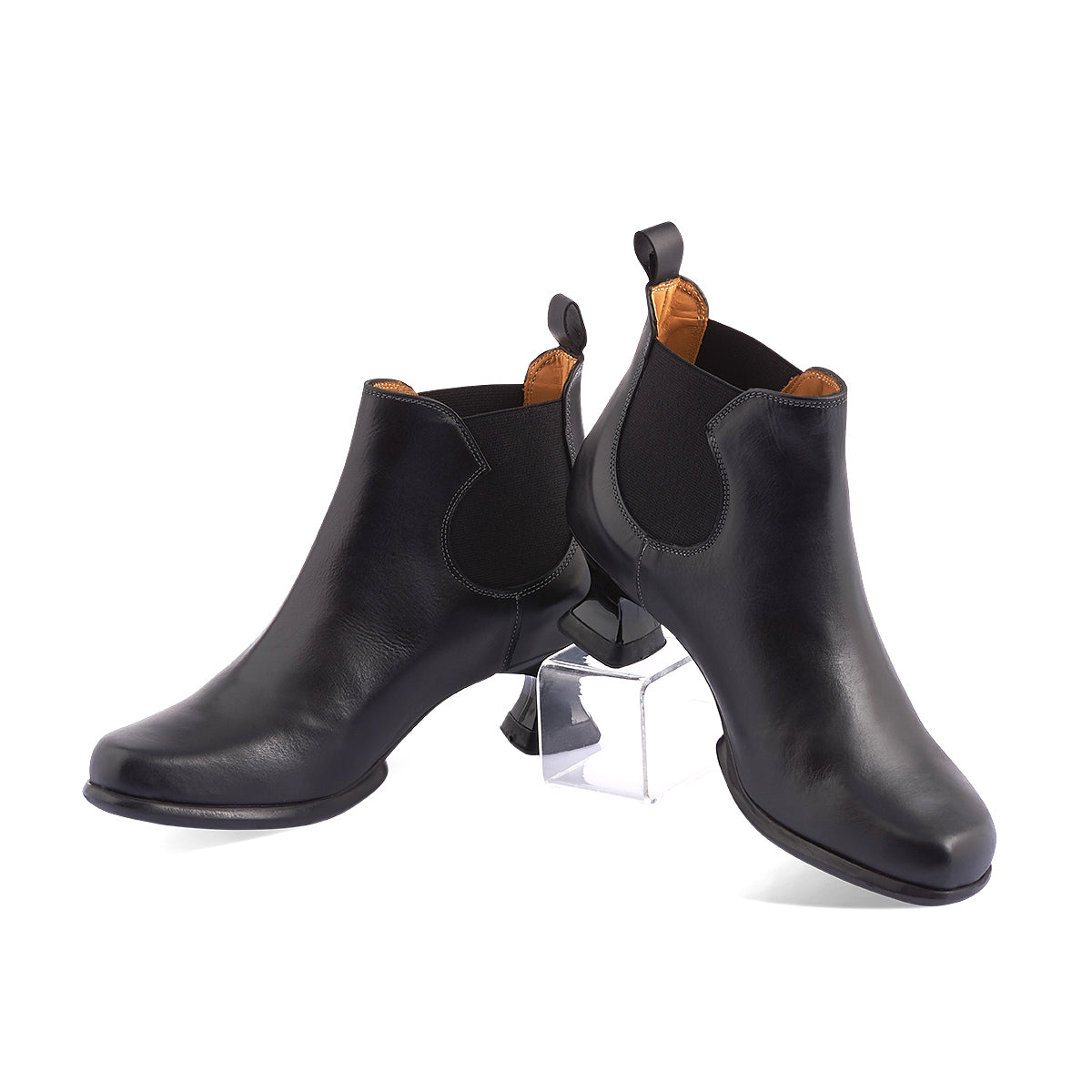 A true Fluevog classic, Danke is John Fluevog's homage to modern Berliner art and design. This functional Chelsea boot features a soft, supple leather upper, sweeping lines and a gorgeous angular toe. The original Wearevers heel and comfy rubber sole are among the most iconic of all Fluevog designs.