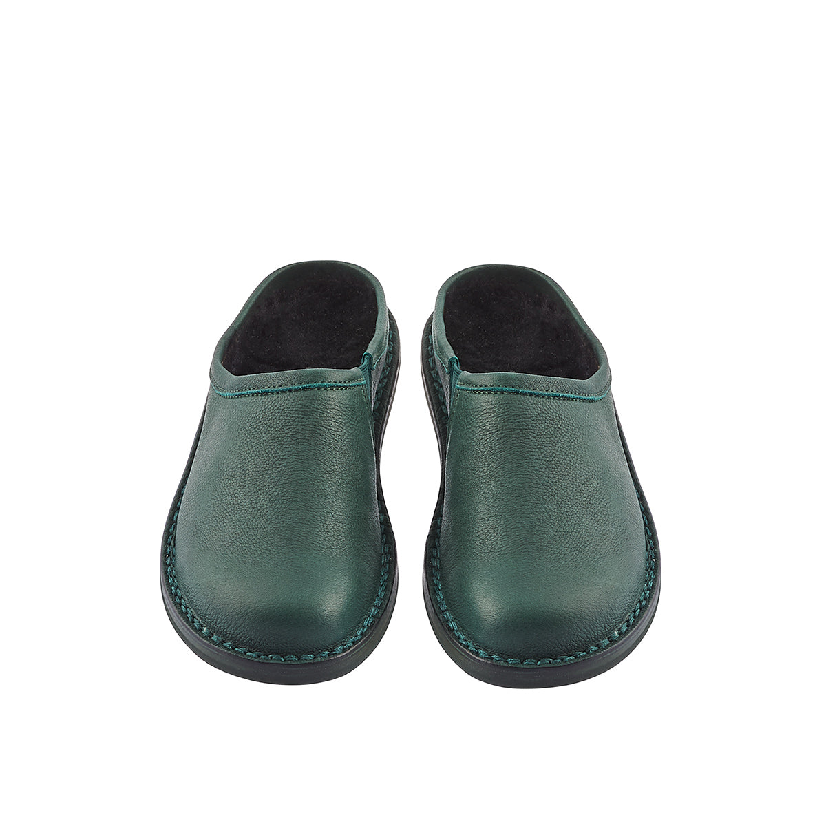 Based on Trippen's iconic style Yen, Half-Yen is a slip-on style with the most luxurious lambswool footbed to keep you feet toasty through winter. The flexible and durable sole is suitable for any surface, while the rich green leather upper will develop a beautiful patina over time.