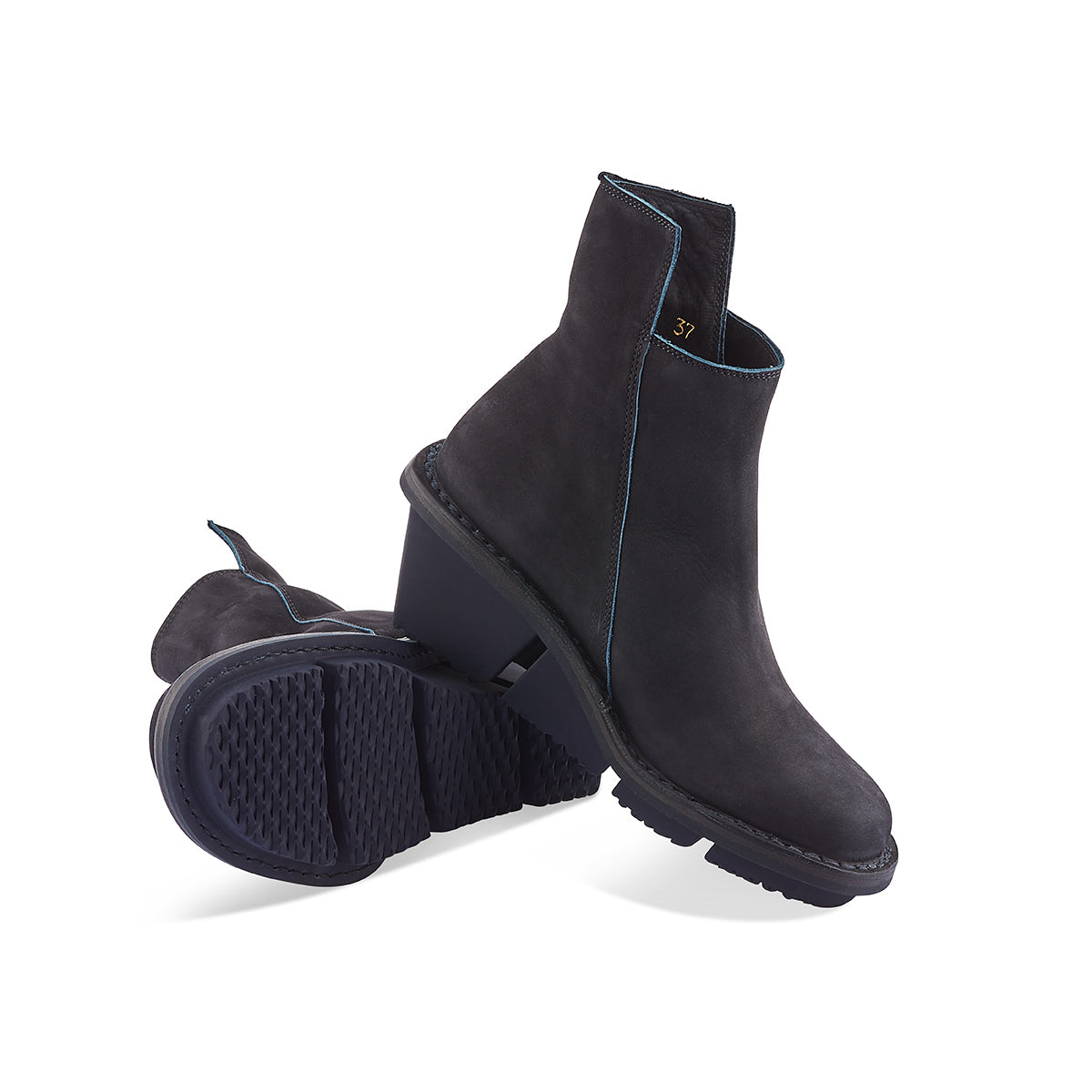 A modern classic, Trippen's Proper wedge boot returns this season in a deep navy nubuck upper. The angular zip and slightly higher back create a beautiful line through the leg, and the sturdy yet lightweight 'gritt' sole provides extra height and the right amount of flexibility underfoot.