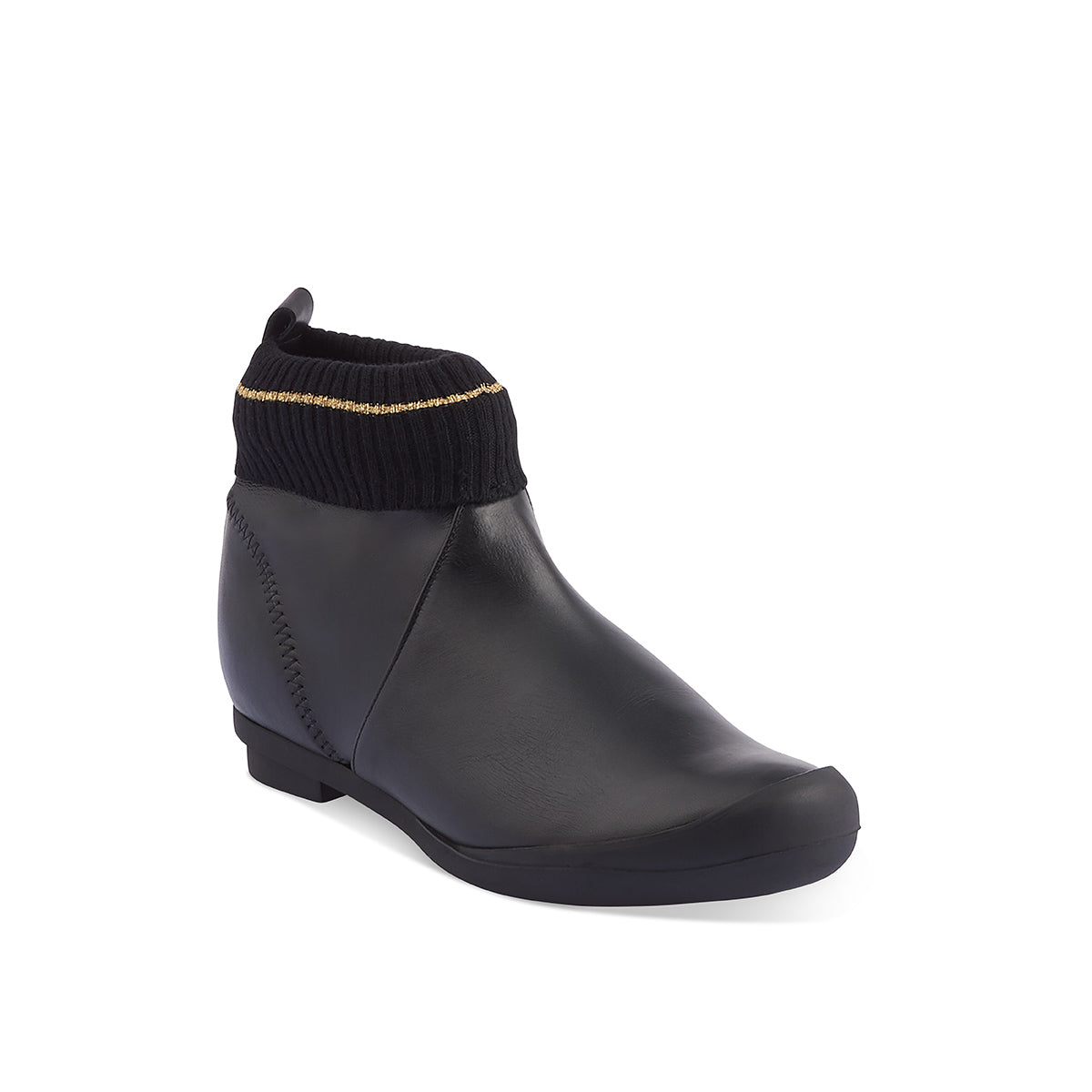 A playful combination of - yep - sock and shoe, Tracey Neuls' adventurous spirit is on display with this amazingly comfy low ankle boot. The slip-on design is made easy with a high-quality 'pleather' back section and the fun sock detail is elevated with a fine line of gold around the ankle.
