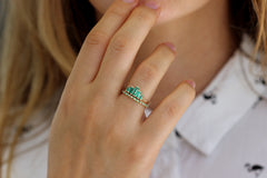 Emerald And Diamond Eternity Wedding Band On Finger