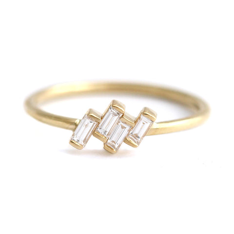 Four Baguette Cut Diamonds Set In A Tilted Composition