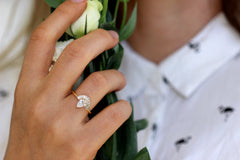 Pear Diamond With Baguette Diamond Crown On Finger