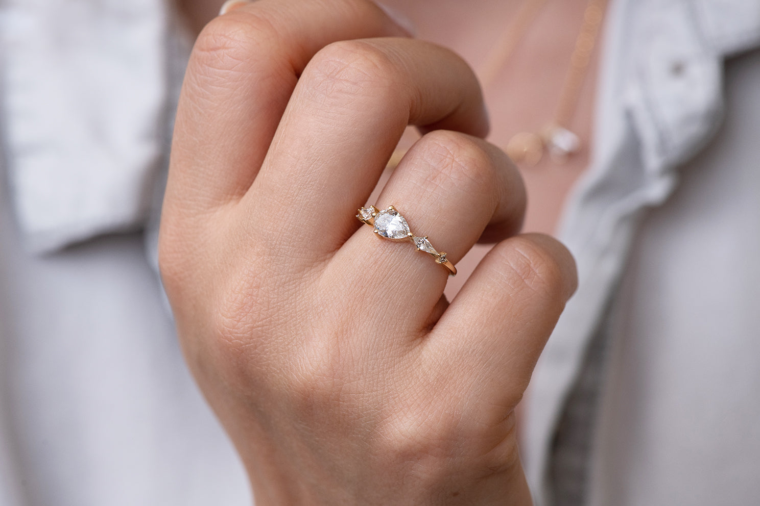 Pear Shaped Engagement Ring - Diamond Lineup Ring Up Close View on Hand