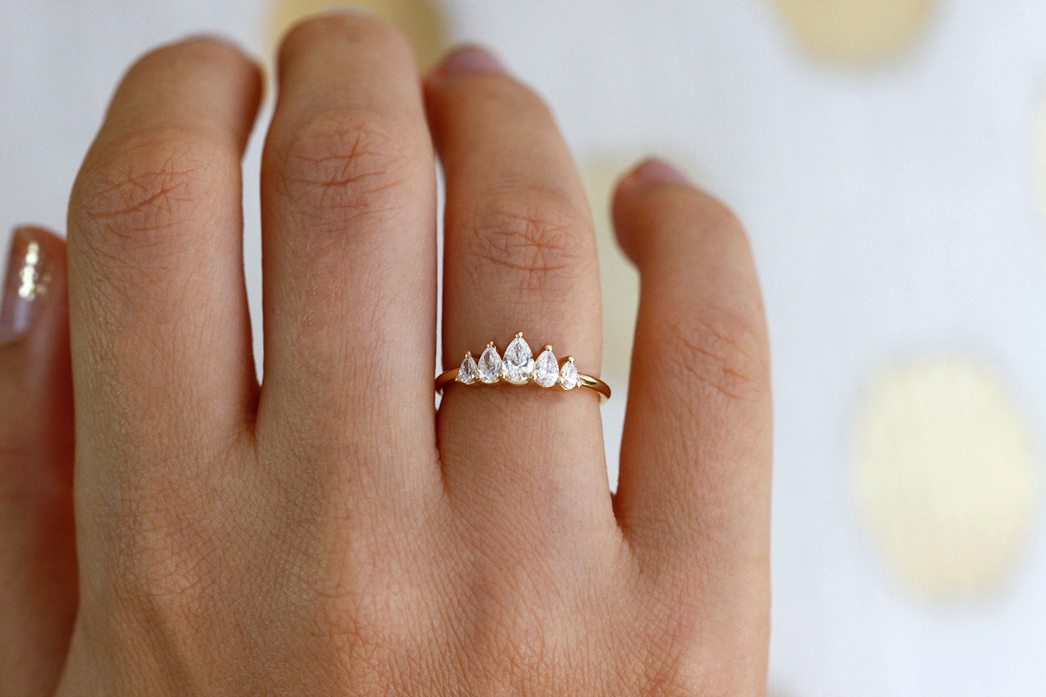 Unique Pear Diamond Engagement Ring On Hand