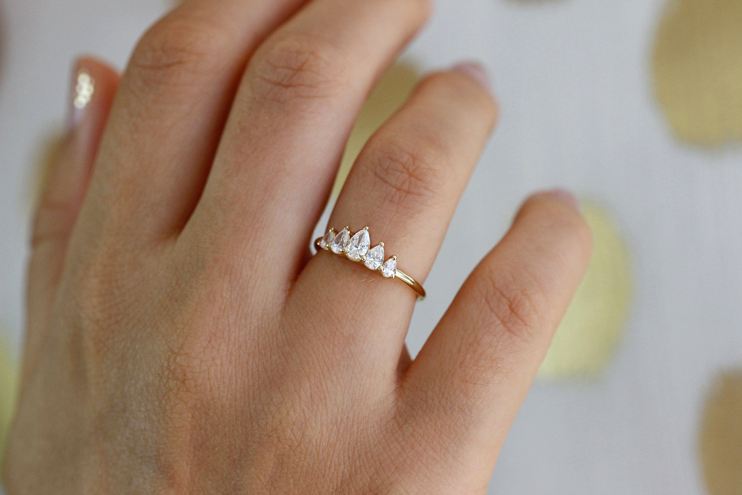 Unique Pear Diamond Engagement Ring On Ring Finger