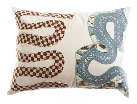Rios Design Embroidered Pillow on stone