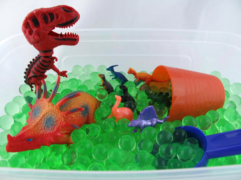 Dinosaur Sensory Bin with Green and Black Water beads