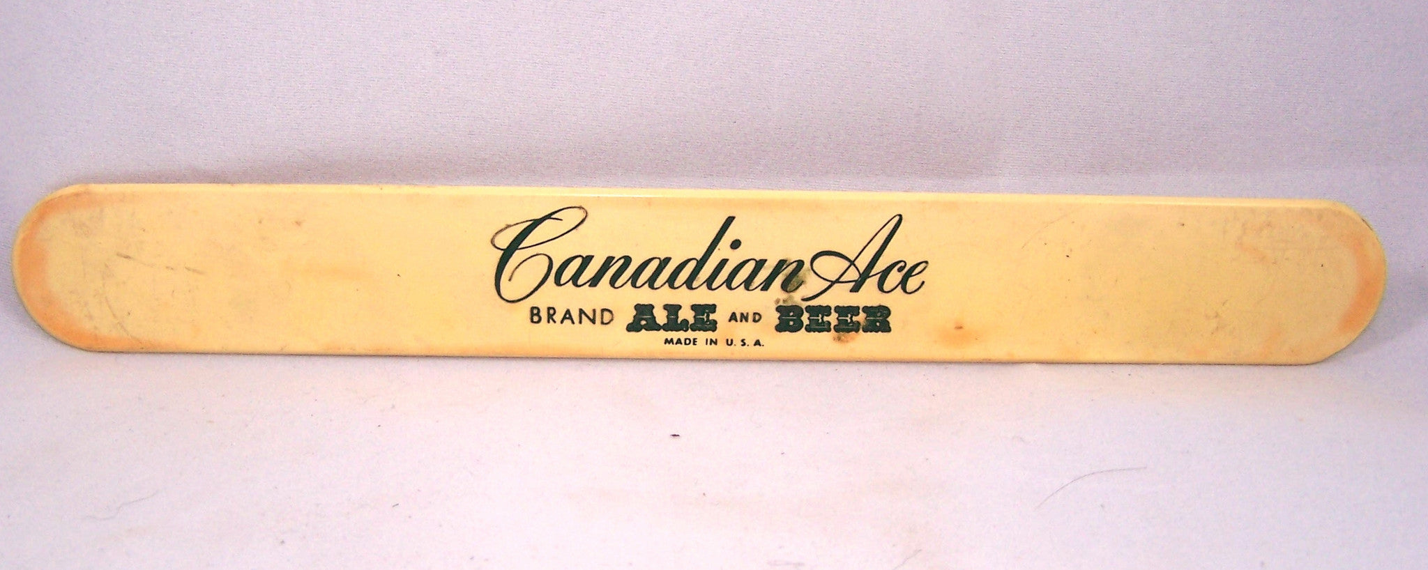 Canadian Ace Brand Ale and Beer foam scraper, two sided.