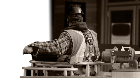 Worker in Harness with winch