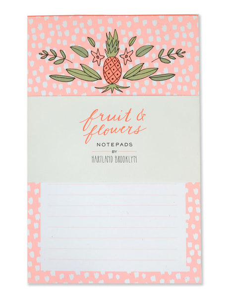 Pink background with white polka dots and fruit & flowers packaging. Illustrated by Hartland Brooklyn.