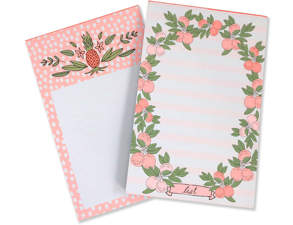 Two chronicle notepads fanned out, one with citrus fruits and stripes and the other with a pink with white polka dot background. Illustrated by Hartland Brooklyn.