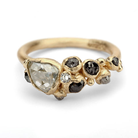 Alternative engagement ring with grey diamonds and raw diamond from Ruth Tomlinson, handmade in London