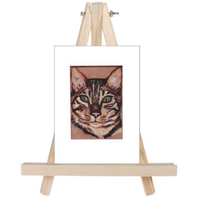 fine art bengal cat on easel