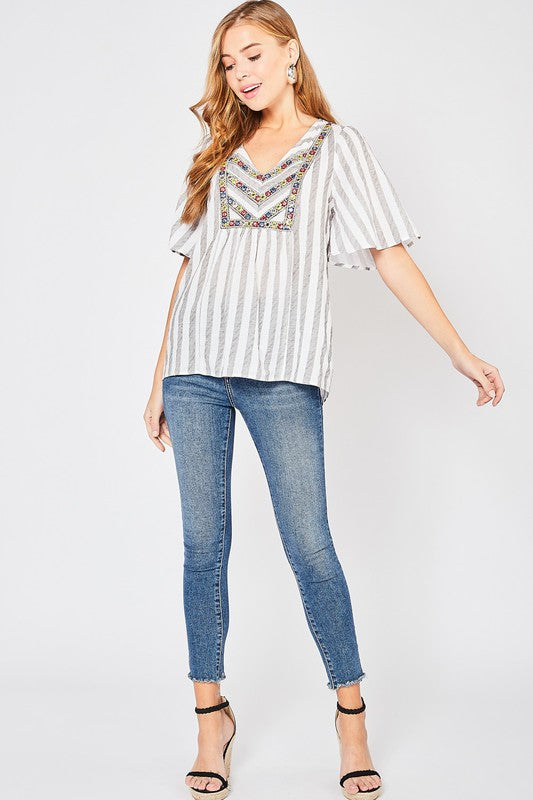 Striped vneck top with embroidery detail