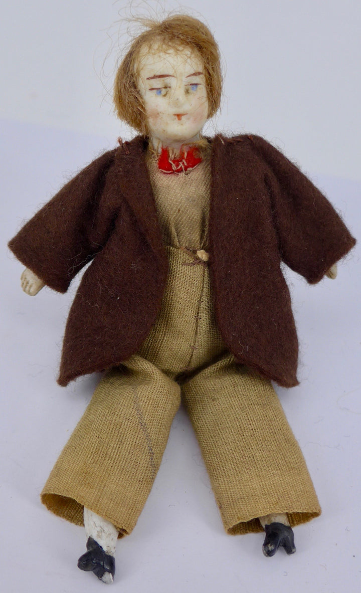 male bisque dollhouse doll, brown suit
