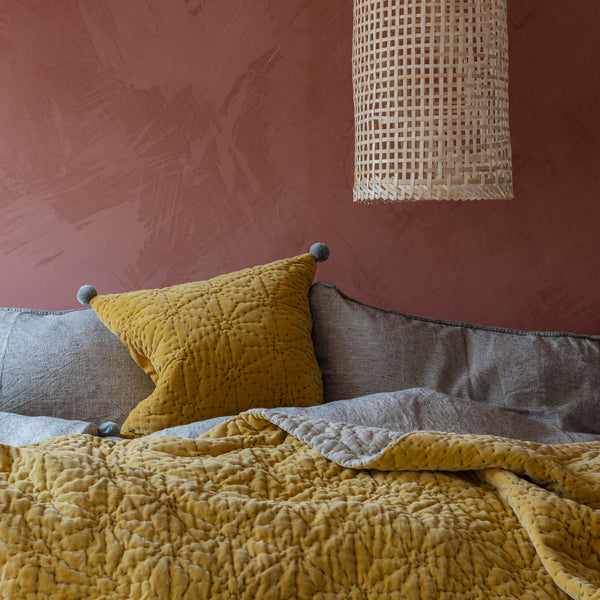 Handmade mustard velvet quilted bedspread with grey pompoms