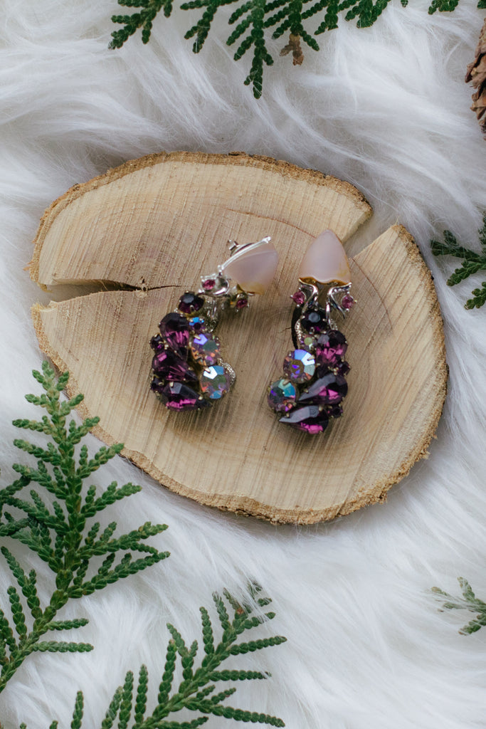 vintage purple rhinestone earrings on wood with greenery holiday handmade in toronto