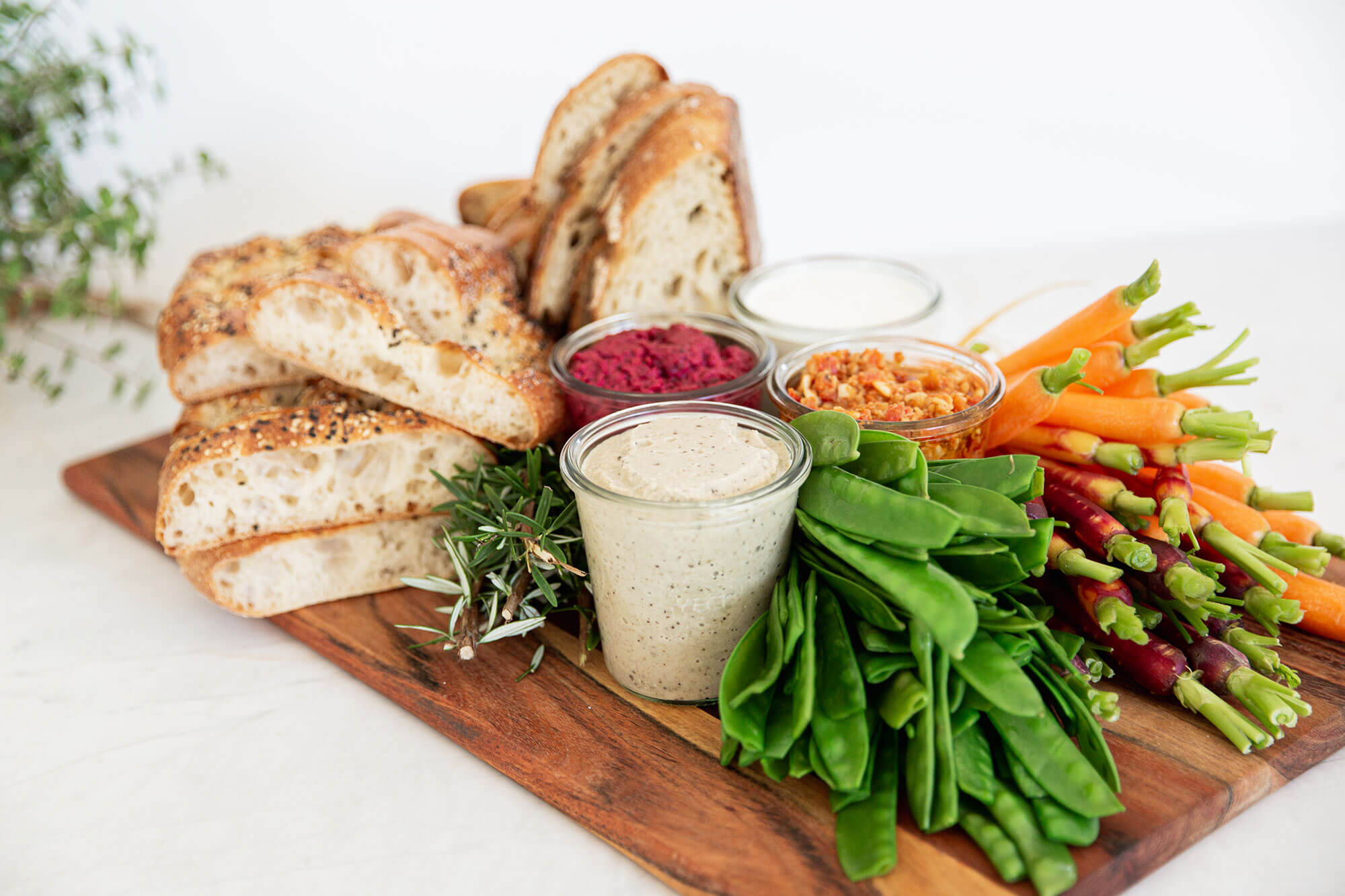 A platter with breads, dips and vegetables from Catroux's Platter Catering Menu