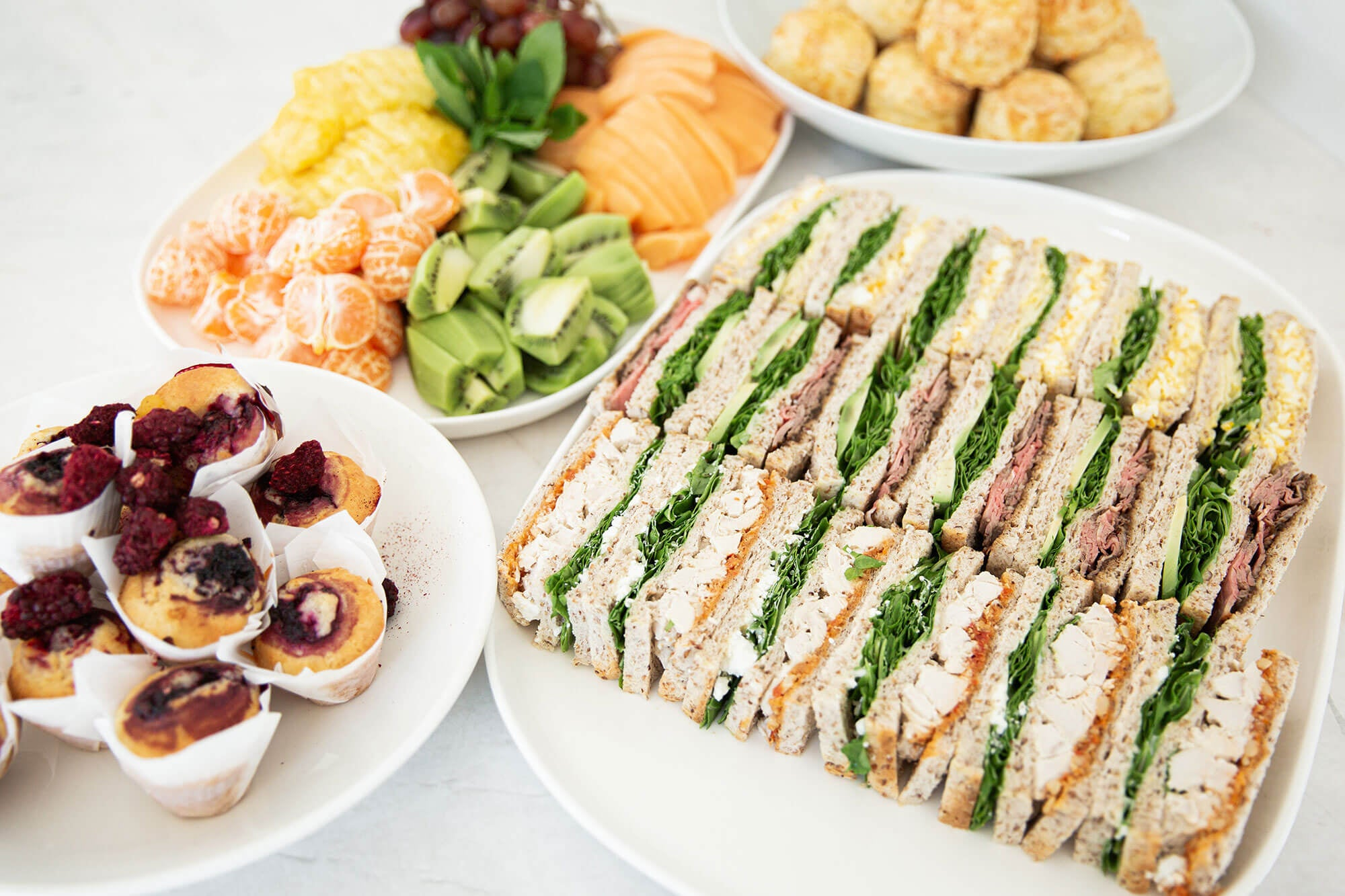 Club Sandwiches, Muffins, Fruit Platter and Scones from Catroux's Morning Tea Catering Menu