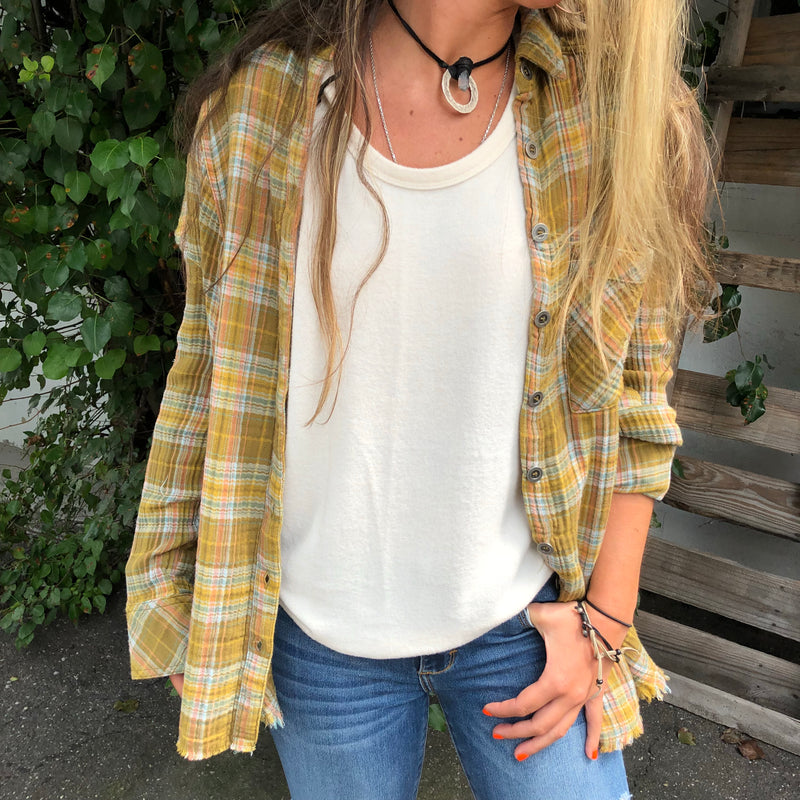 Our cozy, plaid, classic button-down shirt by Free People is so comfy and roomy. Olive color in the softest, cotton flannel which makes this a perfect transition piece you will most definitely want.  Shown with our Coziest Tank in Ivory  100% Cotton