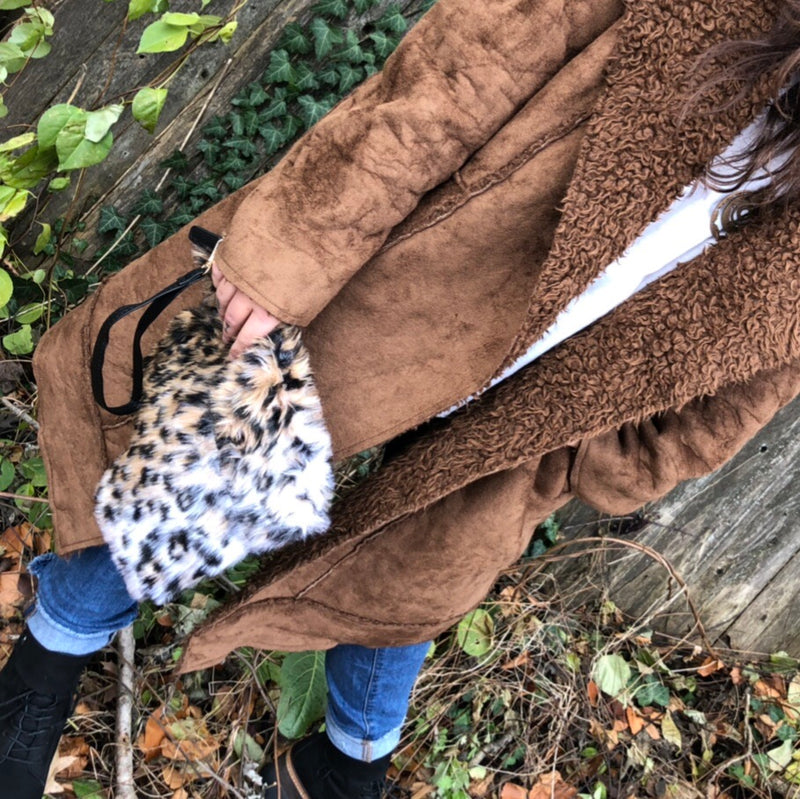Feeling fierce?  This is faux fur leopard print clutch is the perfect addition to your outfit.  With vegan leather wrist strap.  Measures 10