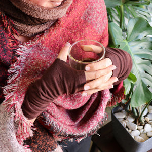 Finger-less winter warmers made with a stretchy cotton knit. Long mitts that are great for staying warm while keeping fingers free. Hot Choc.