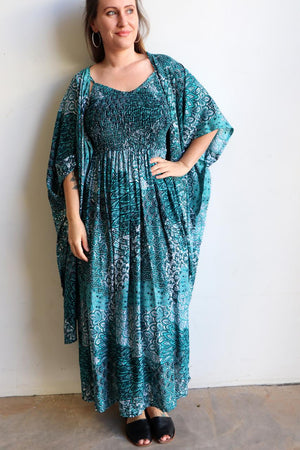 Womens flowy maxi sundress tunic gown with shirred bodice and adjustable spaghetti straps in peacock paisley print. Generous one size fit flatters most from size 10 to 18 or up to 120cm bust - Jade Green