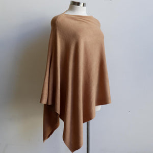 Women's Fine Knit Poncho Wrap. Elegant & versatile winter top can be worn multiple ways.. Made with easy-care acrylic fibre. Camel.