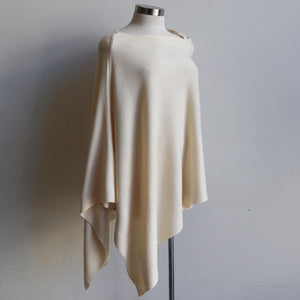 Women's Fine Knit Poncho Wrap. Elegant & versatile winter top can be worn multiple ways.. Made with easy-care acrylic fibre. Cream.