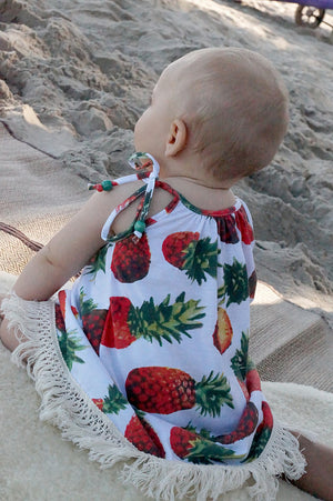 Girl's Sun Dress with tropical pineapple print and cotton fringe. Handmade by our Kobomo team.