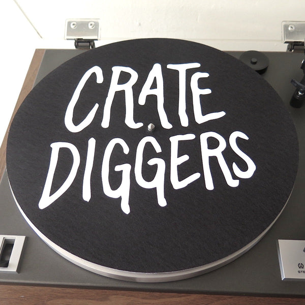 Black felt Crate Diggers slipmat sits on a turntable platter
