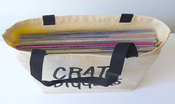High angle view of Crate Diggers tote bag, containing 10-20 vinyl records