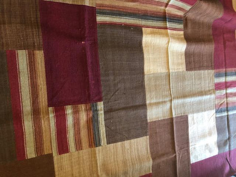 Lined Patchwork handwoven wool and jute rug in several sizes.
