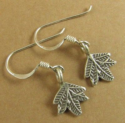 Tiny hanging leaf earrings. Fine and sterling silver. Tribal silver.