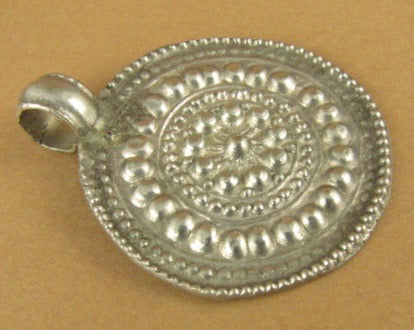 Old /antique Indian Tribal silver pendant. Round. Embossed. Fine silver.