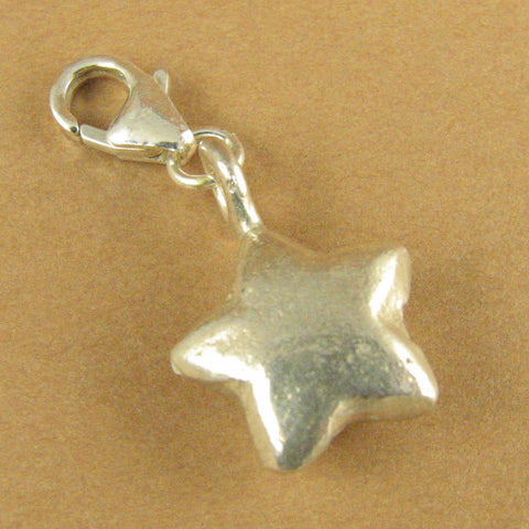 Star clip on charm. 3 dimensional. Lobster clasp. Sterling silver 925.
