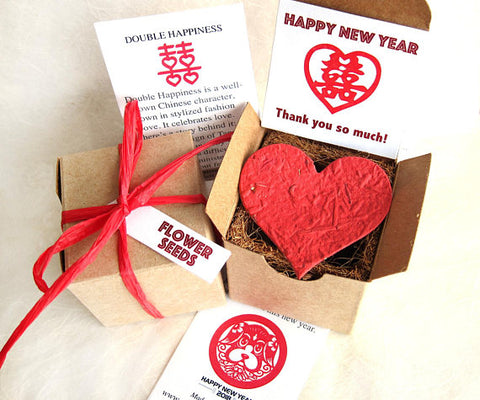 Recycled Ideas Favors plantable paper heart with Lunar New Year-themed gift box
