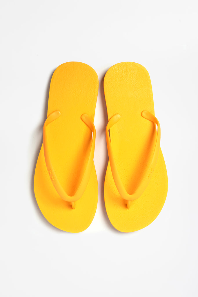 Sustainable women's yellow flops made by Tidal New York