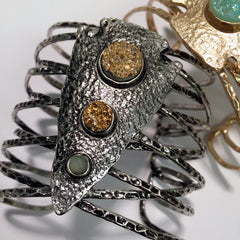 Arrowhead Incredible metal shaped criss cross cuff with spear head carved center piece with druzy