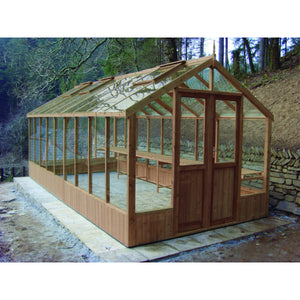 A Swallow Raven 8ft wooden greenhouse finished in natural thermowood