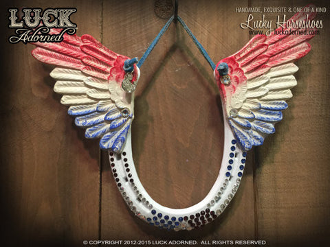 PATRIOT Luck Adorned Lucky Horseshoe is a glossy white horseshoe with wings hand painted in all American style, Red, White & Blue.
