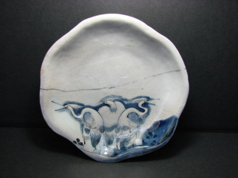 A very rare early Imari moulded blue and white small shaped dish.