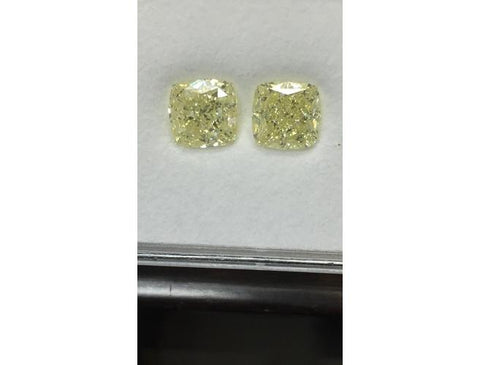 Cushion 7.11 Carat, Fancy Light Yellow, IF-VS2 Pair.