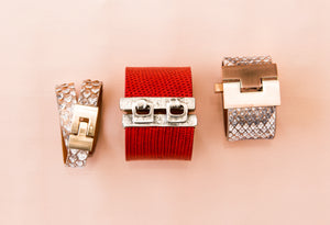 Double jigsaw Python Wrap, Hook eye Red Lizard Cuff, Wide Python Jigsaw Cuff on pink background
