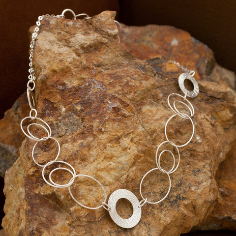 Woven Wreath Sterling Silver and Rhodium Plated Multi-ring Toggle Necklace