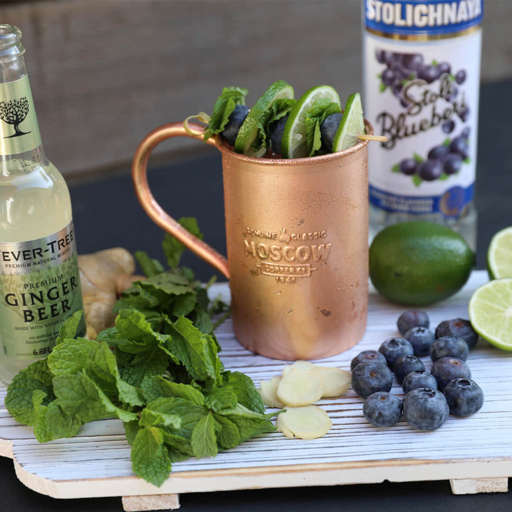 Moscow Copper Co.'s original copper mug gets dressed up with a blueberry Moscow Mule.
