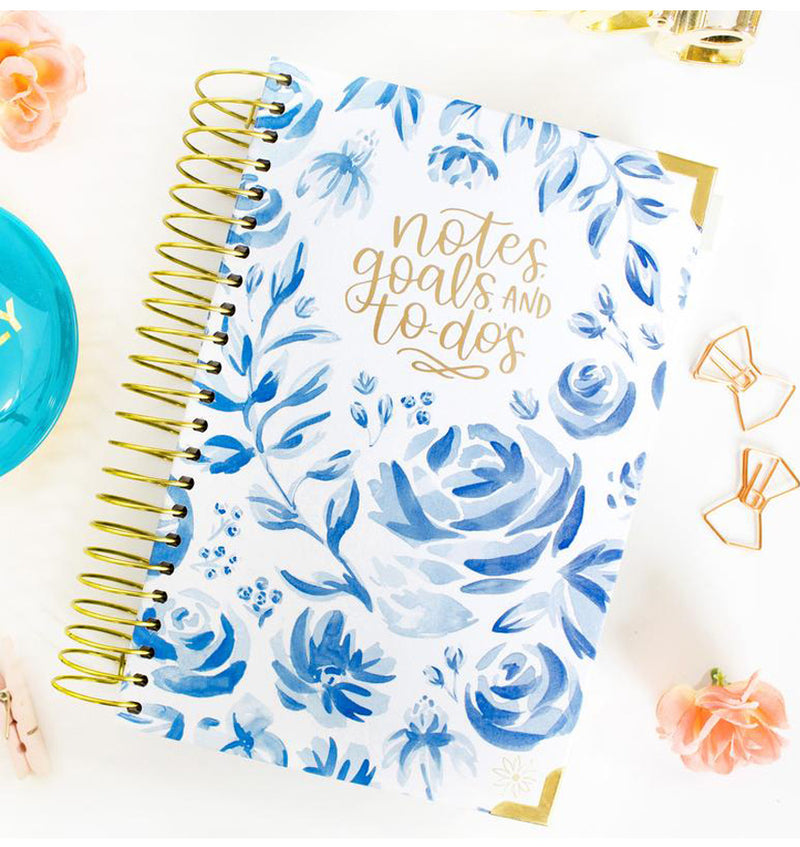 Bloom Blue Floral Daily To Do List Hardcover Planner Undated Cover on a Desk